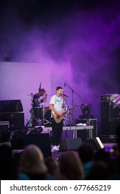 MOSCOW - 14 JULY, 2017: Cool rap & rock singer Noize MC performs on stage.Big open air concert for Russian audience.Young guitar player  singing on stage & rapping to the beat