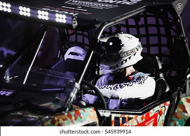 MOSCOW - 14 MARCH,2015: Extreme sport competition show Proryv.Baggy car racer race for the prize.Indoor motor sport contest