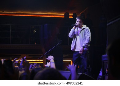 MOSCOW - 14 OCTOBER,2016: Big concert of Russian rap singer Kravz on nightclub Moskva stage.Feduk MC rapping on warm up show