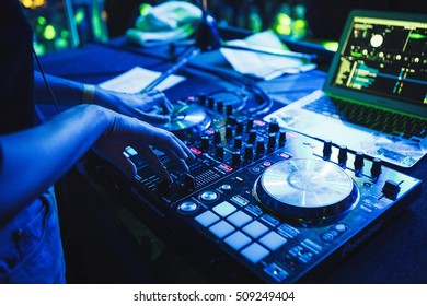 MOSCOW - 14 OCTOBER,2016: Big concert in nightclub.Hands of girl DJ playing music and scratching tracks on professional dj midi controller