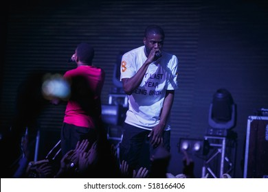 MOSCOW - 15 NOVEMBER,2016:Famous rap band Asap Mob performing live hip hop music show on night club stage.Rapper singer with microphone on scene.Concert in crowded nightclub