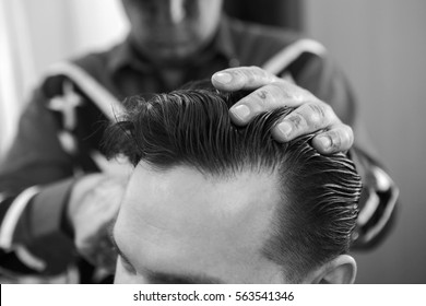 Moscow /17.01.2017/ Hairdresser makes hairstyle man in barbershop