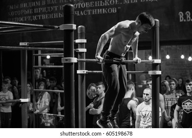 MOSCOW - 18 MARCH,2017: Cool work out championship Arena Gods in indoor sport gym.Young people athletes compete in work out challenge on horizontal bars.Healthy lifestyle activity