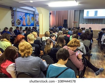 Moscow, 2 January 2018: full Hall of people sitting on the chairs at the conference. people listen to the speaker at the conference. business meeting in a conference hall: people sitting rear