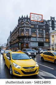 MOSCOW - 2 JANUARY,2017: New Year celebration in capital of Russia.luxury shop TSUM decorated for Christmas holidays.Taxi cab in front of the fashion clothes store