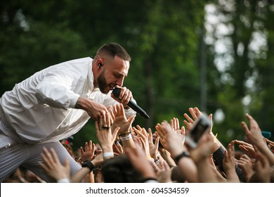 MOSCOW - 2 JUNE,2016: Popular Russian rap singer L'One performing live on outdoor music festival.Famous hip hop singer sing on scene.Entertainment event.Rapper go crowd surfing from stage