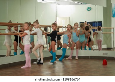 Moscow – 2018: Little ballerina girl. Adorable child dancing classical ballet in a white studio. Children dance. Kids performing. Young gifted dancer in a class. Preschool kid taking art lessons.