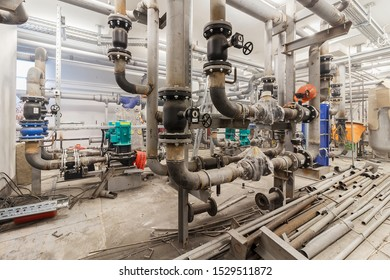 Moscow 2019. Pipelines, fittings, valves and pumps. Boiler room under construction. Electric motor water pump under repair process at power plant.