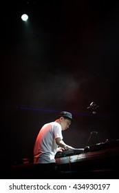 MOSCOW - 21 MAY, 2016 : DMC World DJ event at Yotaspace nightclub.Headliner World Champion - DJ Kentaro.Disc jockey playing music on turntable vinyl record player,hip hop dj scratch records,mix tracks