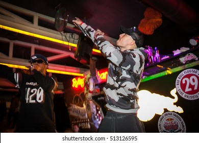 MOSCOW - 21 OCTOBER,2016 : Rapper singer live concert in night club.Rap star performance in nightclub.Hip hop party event,bright stage lighting,portrait of singer
