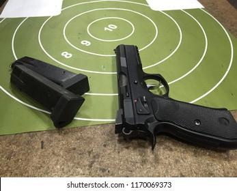 Moscow, 22 August 2018: Gun pistol CZ 75 with gun target. Automatic steel pistol made by Czech firearm manufacturer ČZUB. steel gun, Machine pistol or handgun of Czech. Protection and safety concept