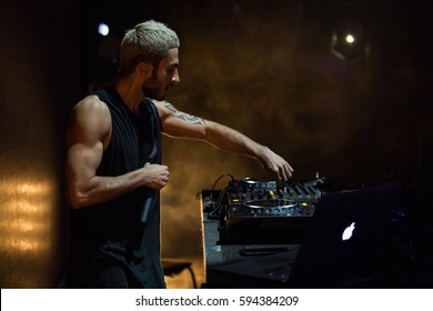 MOSCOW - 22 FEBRUARY,2017: Cool party dj Nerak performing on stage.Popualr edm hip hop & trap music dj play set on scene in night club.Music festival disc jockey play tracks live