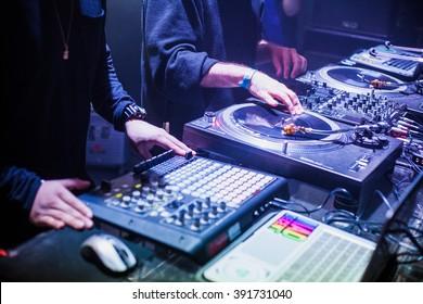 MOSCOW - 22 NOVEMBER, 2015 : Tropkillaz (DJs Laudz and Zegon) present the new album Hearts On Fire in Izvestiya Hall Nightclub.DJ producer play music with Akai MPD drum machine controller.