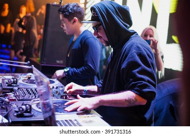 MOSCOW - 22 NOVEMBER, 2015 : Tropkillaz (DJs Laudz and DJ Zegon)play music show in night club on stage.Disc jockey play music show on stage,scratch vinyl records on turntable record player device.