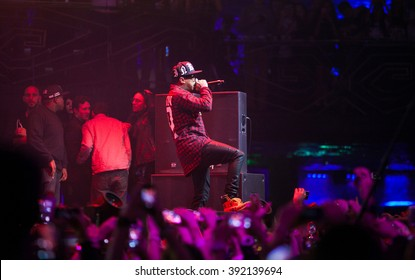 MOSCOW - 22 NOVEMBER,2014 : Famous American rapper Tyga performing on stage in nightclub.Hip hop singer singing on scene.Concert stage lighting,mc sing in microphone.Rap star music concert in club