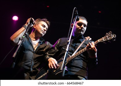 MOSCOW - 26 AUGUST,2016: Singer & vocalist of rock band 7B play live music set on stage in night club.Guitar player performs on scene in nightclub.Entertainment event
