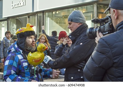 Moscow - 26, March 2017. Forbidden political meeting against a corruption.Journalist interviews demonstrator with toy ducks reminding a film about residence of  Prime minister.