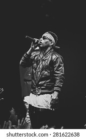 MOSCOW - 26 OCTOBER,2014 : Rap singer Kid Ink performing live music show on night club stage.Hip hop singer sing on scene.Rapper concert in crowded nightclub.Bright stage lighting.Black man rap star