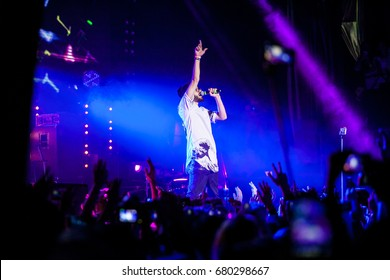 MOSCOW - 27 MARCH,2015: Concert of popular Russian rap singer Mot in nightclub.Hip hop performer on stage in club.Night life entertainment event.Rap music festival