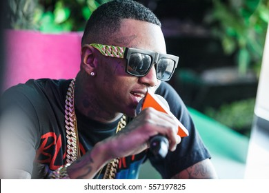 MOSCOW - 27 MARCH,2015: Popular American rap singer Soulja boy interview.Fashionable black tattooed guy talk in microphone.Hip hop celebrity,rap star,famous young black man portrait