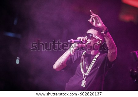 MOSCOW - 27,MARCH,2015: Concert of famous American hip hop celebrity,rap singer Soulja Boy performing on stage in nightclub.Popular rap singer with microphone