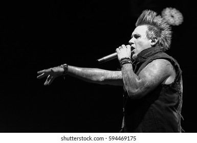 MOSCOW - 28 JUNE,2015: Big hard rock concert of band Papa Roach in night club.Rocker musician play live set on scene in nightclub.Bright stage lighting.Cool live music entertainment event