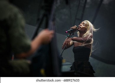 MOSCOW - 29 JULY,2017: Popular darkwave, r&b singer Abra performing live on stage.Young African singer girl sing on scene.Popular pop singer with microphone
