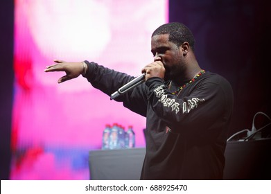 MOSCOW - 29 JULY,2017: Popular rap singer Asap Ferg performing live on stage.Famous American hip hop singer sing in radio microphone on scene