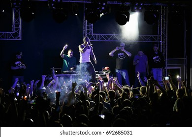 MOSCOW - 3 AUGUST,2017:Concert of rap band Onyx.Oldschool American rap singer Fredro Starr singing live on stage in front of big concert audience.Music festival people put hands up