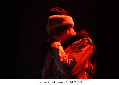 MOSCOW - 30 MARCH,2017: Famous American emo-trap singer Lil Peep performing live set on stage in nightclub.Young rapper with face tattoos sing on scene.Gustav Ahr portrait
