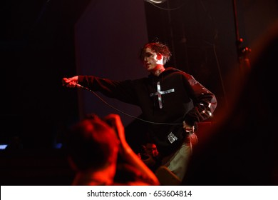 MOSCOW - 30 MARCH,2017: Famous American emo-trap singer Lil Peep performing live set on stage in nightclub.Young rapper with face tattoos sing on scene.Adult night entertainment event