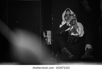 MOSCOW - 30 MARCH,2017: Famous Russian rap singer Pharaoh drink beer sitting on the floor in night club after the concert show