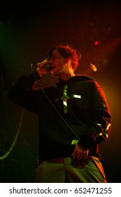 MOSCOW - 30 MARCH,2017:Lil Peep with microphone.Famous American emo-trap singer Lil Peep performing live set on stage in nightclub.Young rapper with face tattoos sing on scene.Gustav Ahr aka Lil Peep