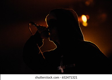 MOSCOW - 30 MARCH,2017:Rapper Lil Peep.Famous American emo-trap singer Lil Peep performing live set on stage in nightclub.Young rapper with face tattoos sing on scene.Adult night entertainment event