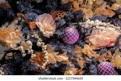 MOSCOW - 30 NOVEMBER, 2017: Beautiful christmas tree in pink, golden and purple colors lavishly decorated with flowers and baubles