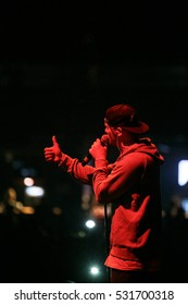 MOSCOW - 4 NOVEMBER,2016: Big concert music show in night club.Entertainment event,live music.Popular rap singer Max Korzh perform hip hop on stage.Portrait of rapper with microphone in red light