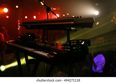 MOSCOW - 5 OCTOBER,2016:Rock band playing live concert on stage of night club.Key board and tambourine on the scene.Keyboards music and microphone stand on scene