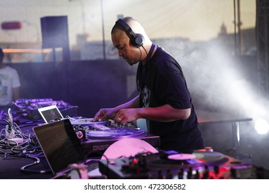 MOSCOW - 6 AUGUST, 2016 : DMC DJ World Russian Finals stage at Faces & Laces Festival.Headliners:Invisibl Skratch Piklz(DJ Q-Bert, DJ D-Styles, DJ Shortkut).Disc jockey scratching records on turntable