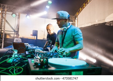 MOSCOW - 6 AUGUST, 2016 : DMC DJ World Russian Finals stage at Faces & Laces Festival. Headliners : Invisibl Skratch Piklz (DJ Q-Bert, DJ D-Styles, DJ Shortkut).DJs play music show on turntables