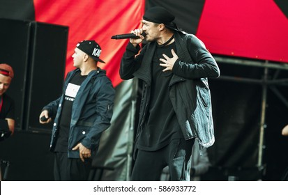 MOSCOW - 6 SEPTEMBER,2014 : Big Russian hip hop rap music live concert at Luzhniki Stadium.Famous rap band Kasta sing on stage.Summer outdoor music festival.