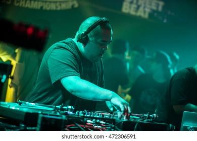 MOSCOW - 7 AUGUST, 2016 : Invisibl Skratch Piklz (DJ Q-Bert,DJ D-Styles,DJ Shortkut) judging Russian DMC DJ finals.Disc jockey play music show on stage,scratch vinyl records on turntable record player
