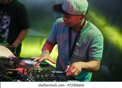 MOSCOW - 7 AUGUST, 2016 : Invisibl Skratch Piklz (DJ Q-Bert,DJ D-Styles,DJ Shortkut) at Russian DMC DJ finals.Disc jockey play music show on stage,scratch vinyl records on turntable record player