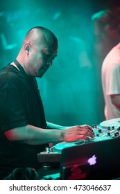 MOSCOW - 7 AUGUST, 2016 : Invisibl Skratch Piklz (DJ Q-Bert, DJ D-Styles, DJ Shortkut) judging Russian DMC DJ finals. Portrait of D-Styles scratching hip hop records with music on turntable player
