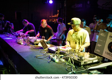 MOSCOW - 7 AUGUST, 2016 : Invisibl Skratch Piklz (DJ Q-Bert, DJ D-Styles, DJ Shortkut) judging Russian DMC DJ finals.Famous DJs playing music show on stage on turntables vinyl records player