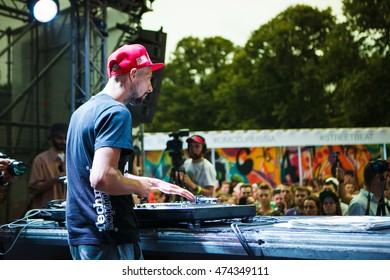 MOSCOW - 7 AUGUST, 2016 : Invisibl Skratch Piklz (DJ Q-Bert, DJ D-Styles, DJ Shortkut) judging Russian DMC DJ finals.Hip hop disc jockey scratching vinyl record with music.Professional audio equipment