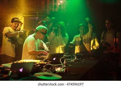 MOSCOW - 7 AUGUST, 2016 : Invisibl Skratch Piklz (DJ Q-Bert,DJ D-Styles,DJ Shortkut)at Russian DMC DJ finals.Disc jockey play music show on stage,scratch vinyl records on turntable record player