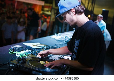 MOSCOW - 7 AUGUST, 2016 : Invisibl Skratch Piklz (DJ Q-Bert, DJ D-Styles, DJ Shortkut) judging Russian DMC DJ finals.Disc jockey playing music on turntable, scratching hip hop records.Pro equipment