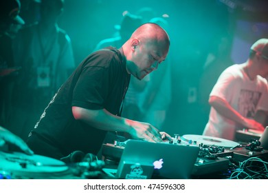 MOSCOW - 7 AUGUST,2016 : Invisibl Skratch Piklz (DJ Q-Bert,DJ D-Styles,DJ Shortkut)at Russian DMC DJ set.Disc jockey play music show on stage,scratch vinyl audio records on turntable record player.