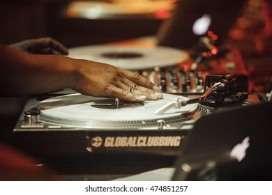 MOSCOW - 7 AUGUST,2016 : Invisibl Skratch Piklz (DJ Q-Bert, DJ D-Styles, DJ Shortkut) playing on stage from vinyl records on turntables.Disc jockey scratching record with music.DJ playing on turntable