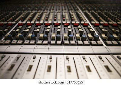 MOSCOW - 7 JULY,2016: Professional mixer in sound recording studio.Volume regulator knobs.Record voice and music in high quality.Mixing console for audio engineer